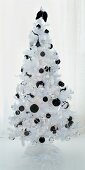 A white Christmas tree with black baubles