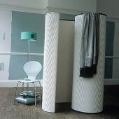 Movable changing room beside a chair