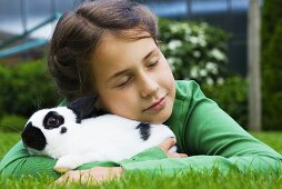 A girl hugging a rabbit