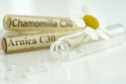 Globuli (homeopathic remedies) with chamomile flowers