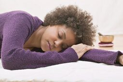Young woman asleep during a relaxation exercise