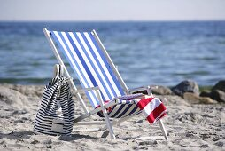 Blue and white striped deckchair by the sea