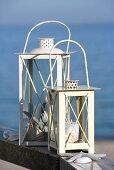 Two white lanterns by the sea