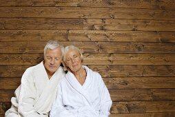 Germany, Senior couple wearing bath robes