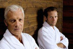 Germany, two men in bathrobe, portrait