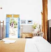A Mediterranean bedroom with a door leading to a garden