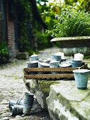 Candles in zinc cups on a stone wall