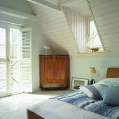 Maritime bedroom with sloping attic ceiling in house with gable roof