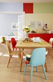 Colourful dining room with view into living room painted pale blue