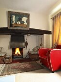 A fire burning fireplace in the living room of an English country house