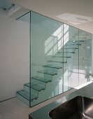 See through stairwell with glass divider and glass stairs