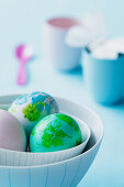 Easter eggs in a stripy bowl