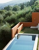 View of a pool and an outdoor shower in the designed garden in a Mediterranean landscape