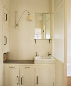 Simple, white bathroom with wash basin and vanity