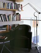 Cozy reading corner with antique leather armchairs and chrome floor lamps in retro style