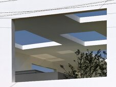 Contemporary patio cover with square cut outs and view of the sky