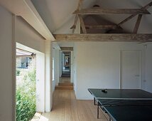 Table tennis table in the lobby of a converted barn