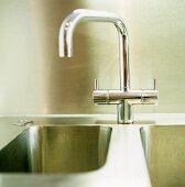 A chrome designer kitchen tap on a sink