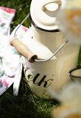 An old fashioned enamel milk can