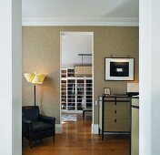 Modern, classic living room with open doorway and view of dressing room