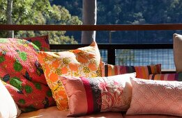 Scatter cushions on sofa on terrace