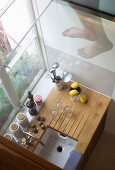 Looking down onto tiny kitchen unit with kitchen implements in window niche