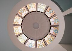 View of modern, circular cupola with stained glass windows