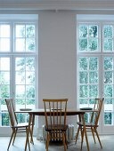 50s retro kitchen table and chairs in front of classic terrace doors