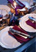 White china plates decorated with carol lyrics on festively set table