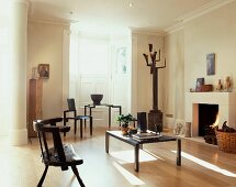 Rustic and modern wooden chairs in modern living room with a classic atmosphere