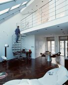 Open-plan living in converted loft with gallery and spiral staircase