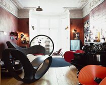 Designer seating and Bauhaus shelves in a luxurious room of a Baroque villa