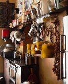 Corner of nostalgic kitchen with kitchen utensils under modern shelving