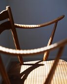 Pattern of light and shade on 50s-style wooden chair