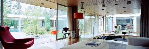 Bauhaus period furniture in spacious living space with open sliding terrace doors