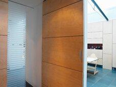 View through open sliding door to dining room