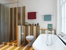 Bathroom with multi-coloured tiling