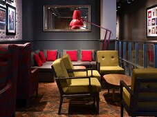 Mixture of seating styles with comfortable retro upholstery on worn fishbone parquet