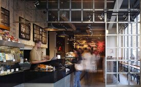 London coffee shop with floral mural and metal-framed partition