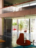 Living space with glass walls & gallery