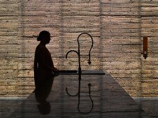 Woman standing at kitchen island sink