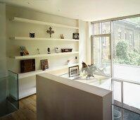 Gallery with shelving & balcony door