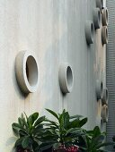 Concrete exterior wall with round window niches