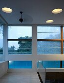 Large windows & round skylights in hall