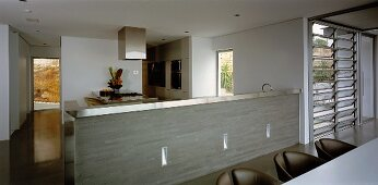 Open-plan, stainless steel kitchen