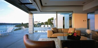 Spacious veranda with leather sofa & coffee table