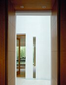 View through doorway into white foyer of contemporary house
