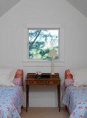 Twin beds in attic room