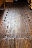 Old floorboards with repaired area