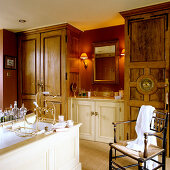Vintage bathroom with fitted cupboards and traditional washstand